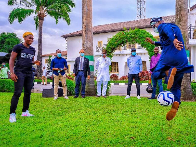'Lovely' Asisat Oshoala stunned as Sanwo-Olu shows off football skills (Photos)