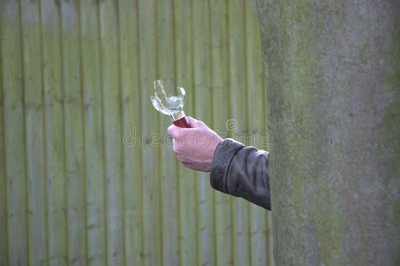 'Busted' Man arrested for stabbing neighbor with broken bottle