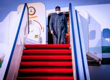 'Back home!' President Buhari returns to Nigeria after medical checkup in London (photos)