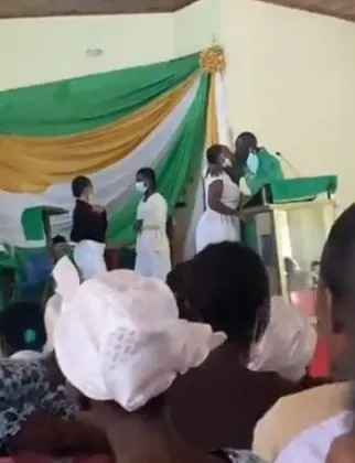 'Outrageous' Reverend gives female students holy kiss on podium (Video)